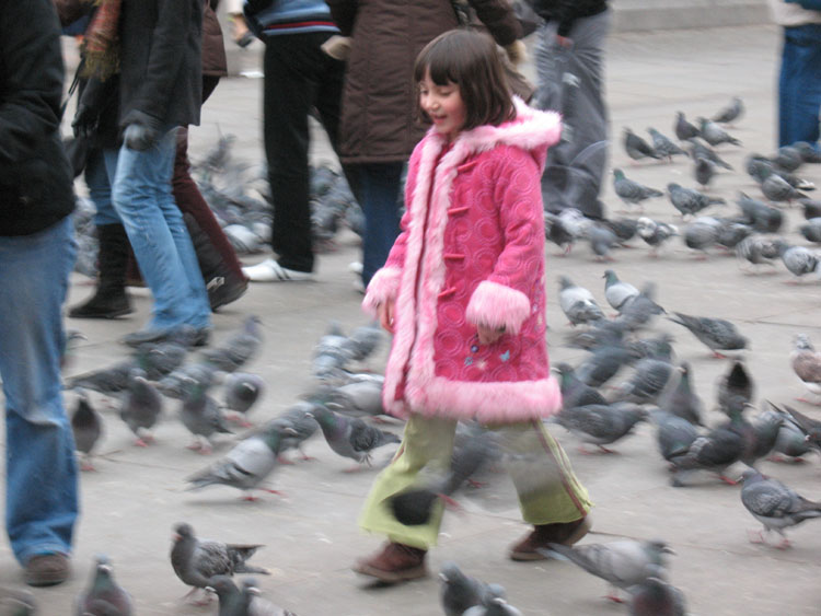 The little girl in the pink coat